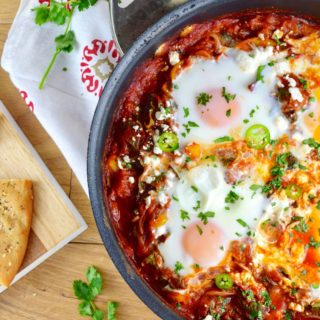 Spicy Shakshuka with Greens and Feta