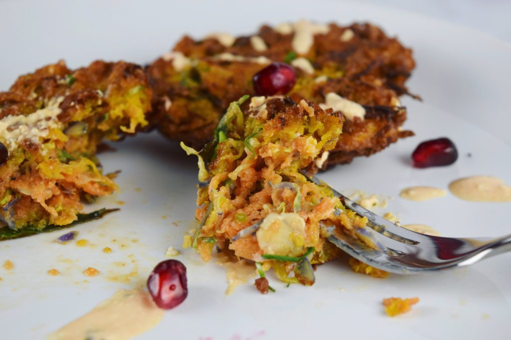 Sweet Potato Brussels Latkes Plate with Fork Closeup